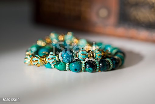 istock Beautiful bracelets with gemtones and wooden beads 805012012