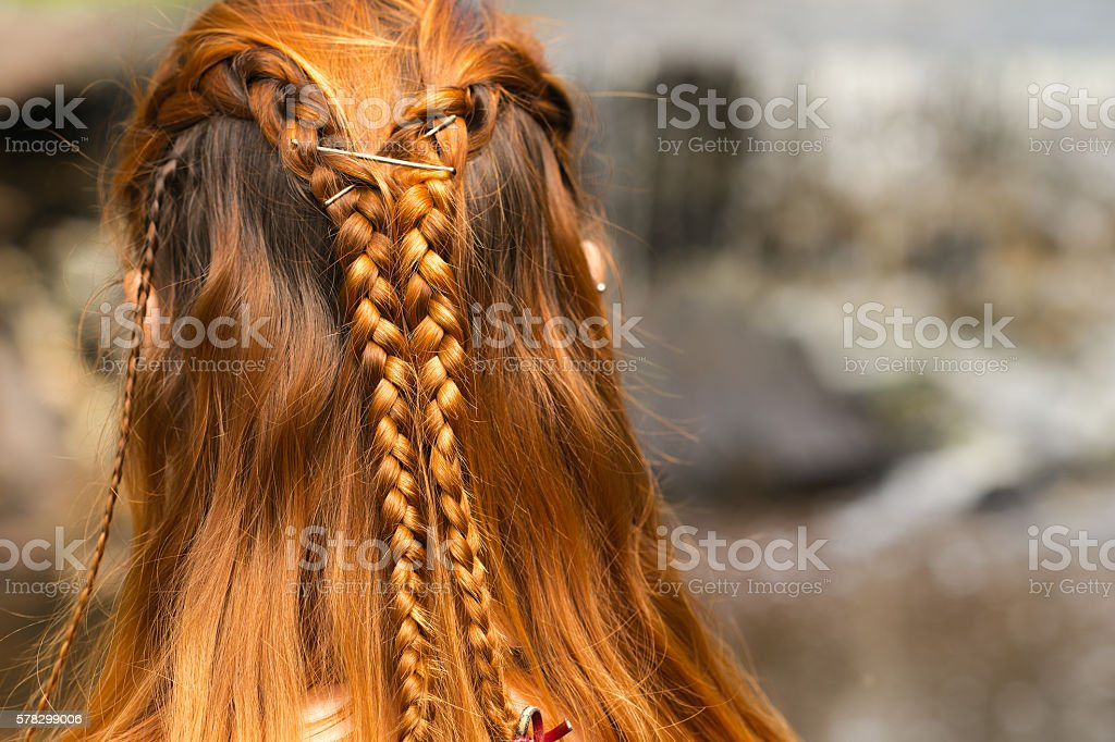 beautiful braid hairstyle on redhead woman stock photo