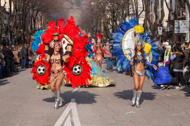 Beautiful Brazil dancers dancing Samba on the streets of the city Monfalcone, Italy on Carnival. stock photo