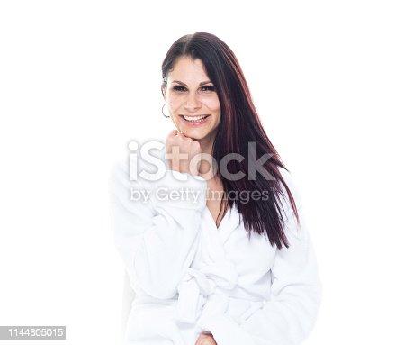 Beautiful Brazilian female wearing a bathrobe