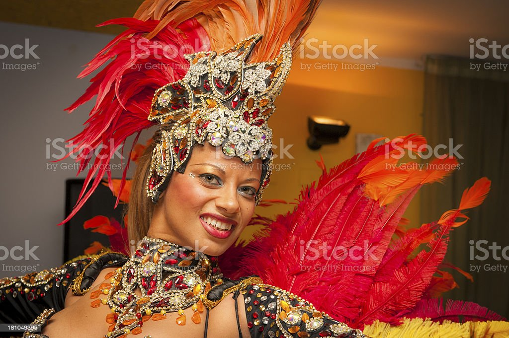 Beautiful Brazilian Girl Smiling and Dancing with Multicolored Costume royalty-free stock photo