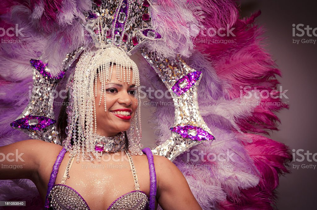 Beautiful Brazilian Girl Smiling and Dancing with Vibrant Costume stock photo
