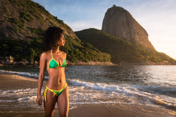 Beautiful Brazilian Girl Walking in the Beach stock photo