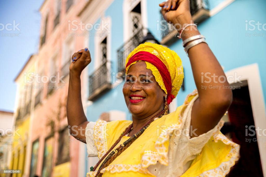 Beautiful Brazilian woman 'Baiana' with local costume in Pelourinho, Salvador, Bahia stock photo