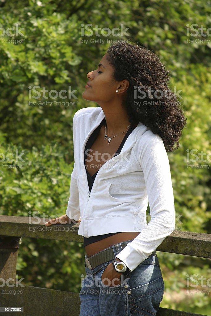 Beautiful brazilian woman enjoying the sunshine royalty-free stock photo