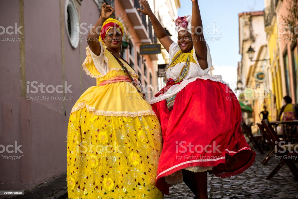 Beautiful Brazilian women 'Baiana' with local costume in Pelourinho, Salvador, Bahia stock photo