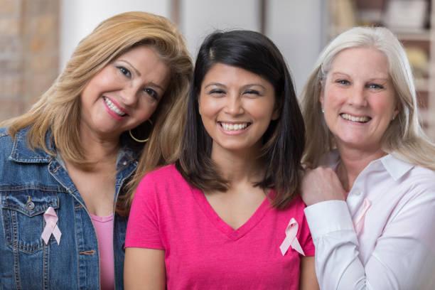 Beautiful breast cancer survivors stock photo