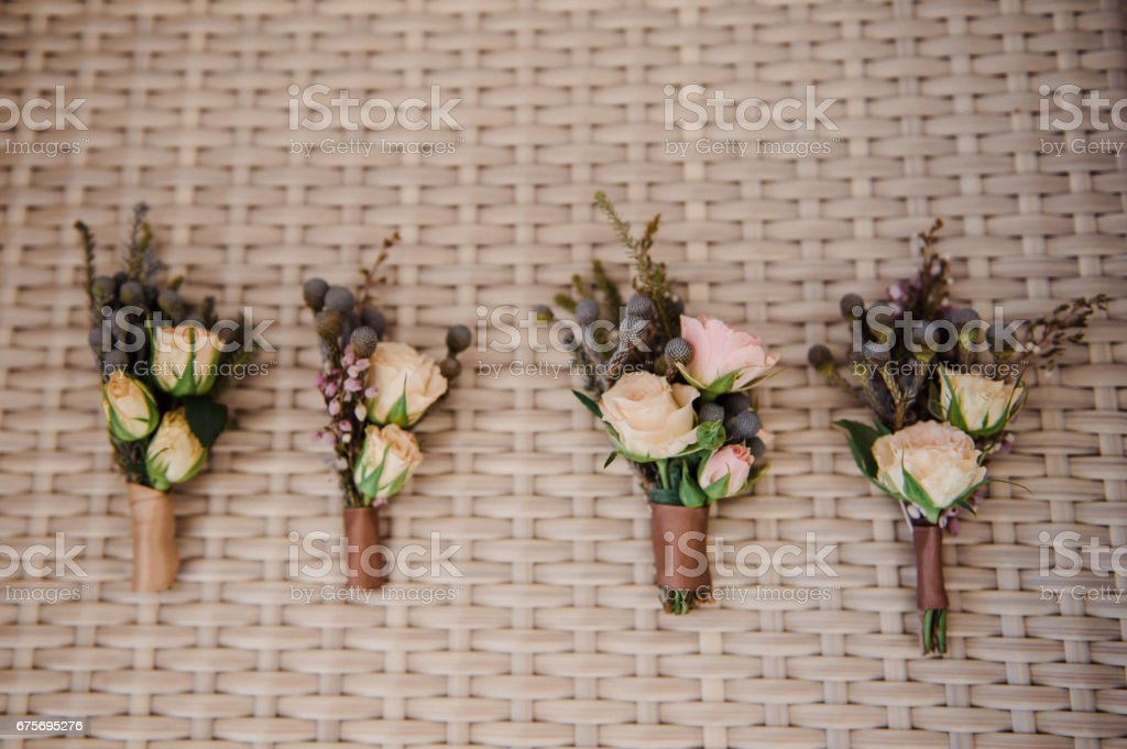 Beautiful bridal bouquet and boutonniere. Wedding floristry royalty-free stock photo