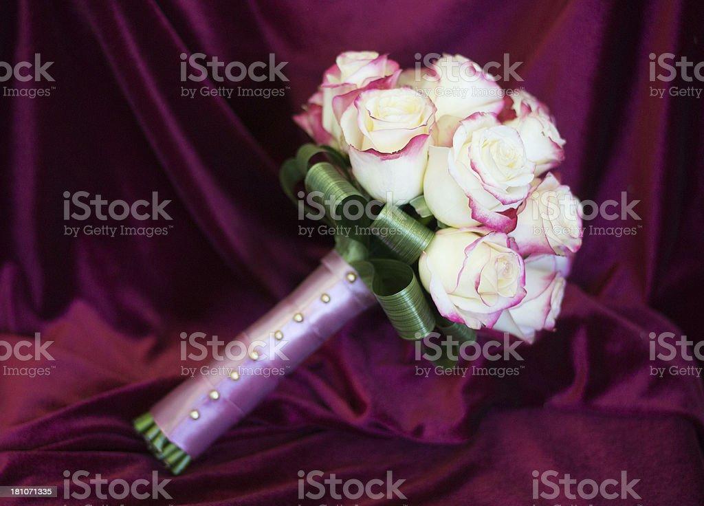 Beautiful bridal bouquet on silk velvet background royalty-free stock photo