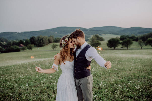 beautiful bride and groom at sunset in green nature. - wedding stock photos and pictures