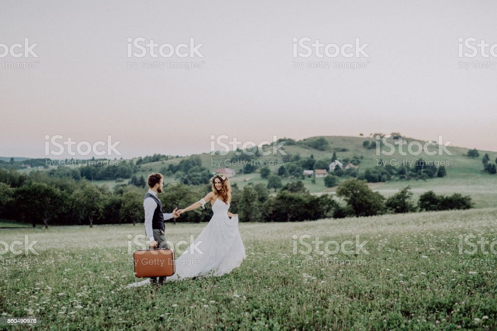 Beautiful bride and groom at sunset in green nature. stock photo