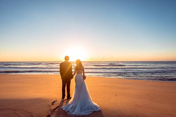 Beautiful bride and groom at the beach Happy couple honeymoon stock pictures, royalty-free photos & images
