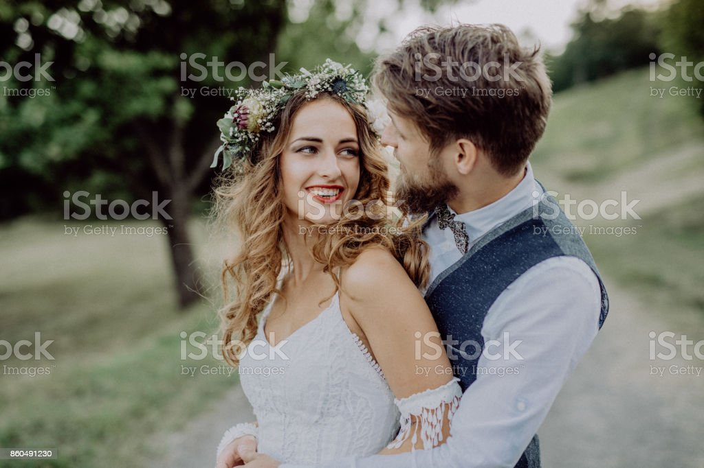Beautiful bride and groom in green nature. stock photo