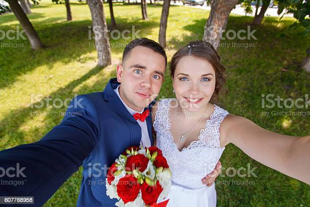Beautiful bride and groom taking a selfie with outdoors picture id607768958?b=1&k=6&m=607768958&s=612x612&h=6ydlsl9v5mqguznqe8wopjsqcpfkywbnal6kd2eyki0=