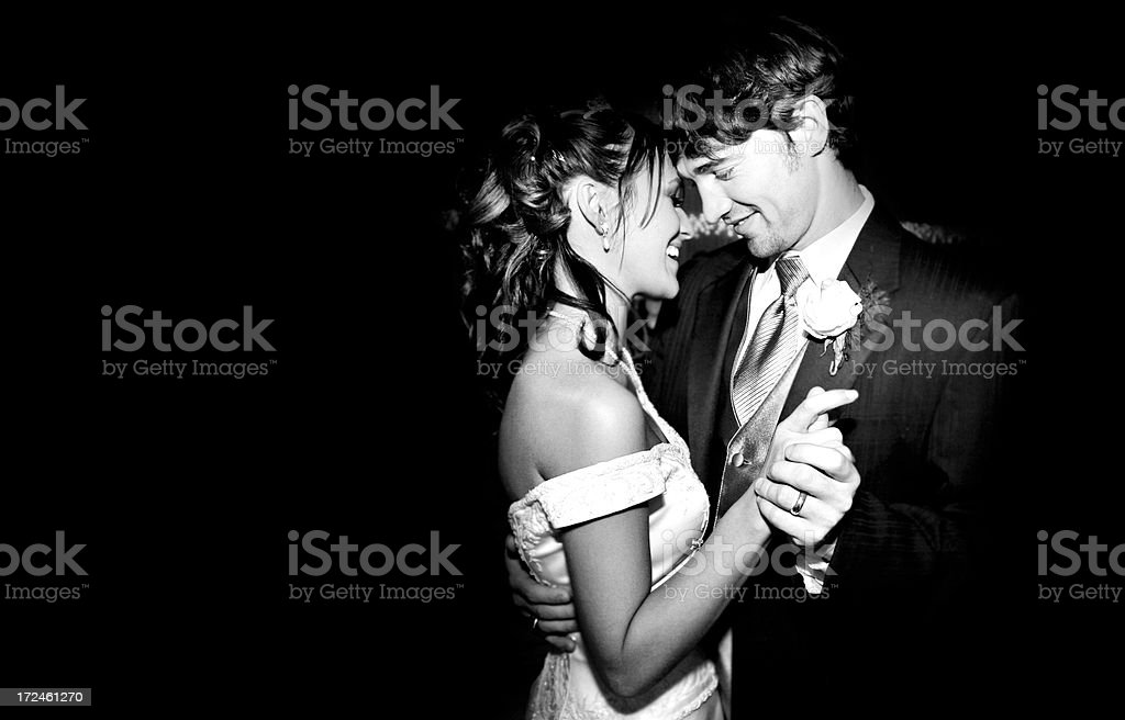 Beautiful Bride and Groom Wedding Dress Dancing B/W stock photo