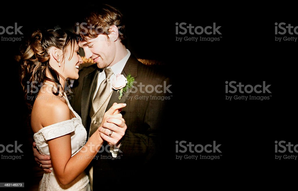 Beautiful Bride and Groom Wedding Dress Dancing stock photo