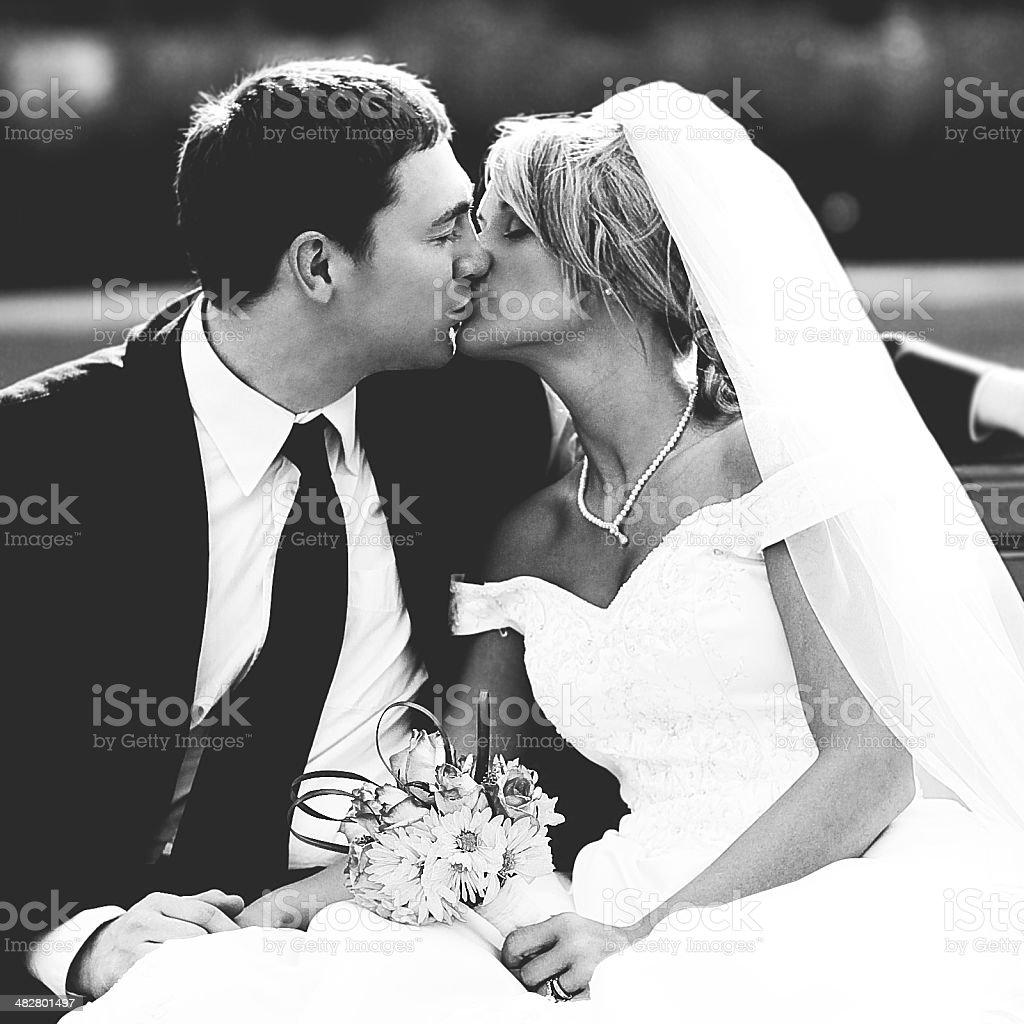 Beautiful Bride and Groom Wedding Dress Kissing stock photo