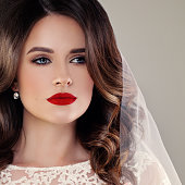 Beautiful Bride Fashion Model, Closeup Wedding Portrait. Woman Fiancee with Curly Hairstyle and Event Makeup on Background with Copy Space