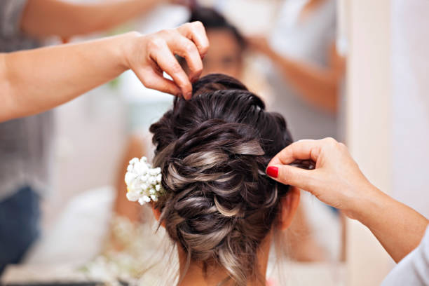 Beautiful bride getting ready for the happiest day of her life stock photo