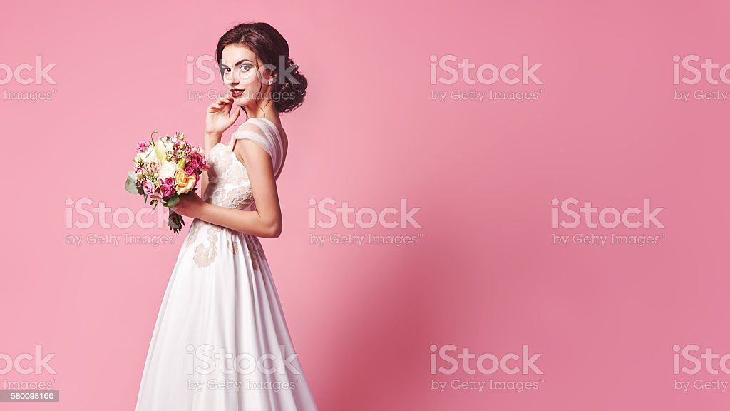 Beautiful bride in a luxurious wedding dress stock photo