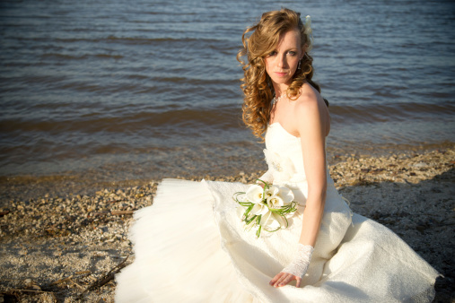 674214372 istock photo Beautiful bride in a white dress on coast of river 480892857