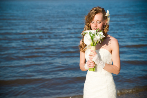674214372 istock photo Beautiful bride in a white dress on coast of river 481463897