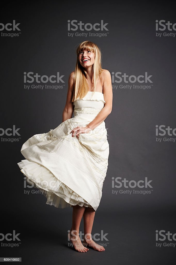Beautiful bride in gray studio, smiling stock photo