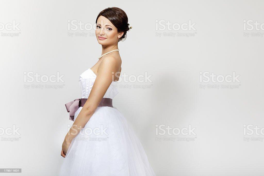 Beautiful bride in wedding dress stock photo