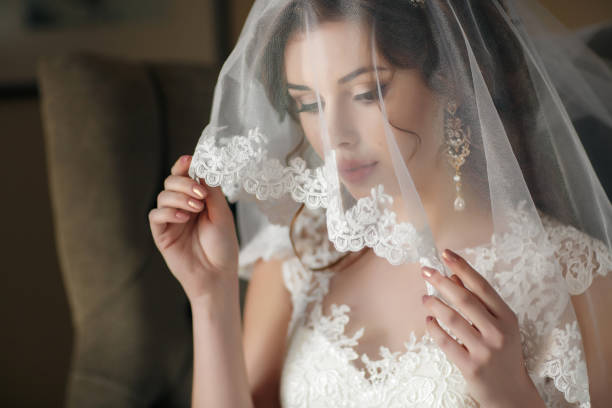 beautiful bride in white wedding dress and veil - veil stock pictures, royalty-free photos & images