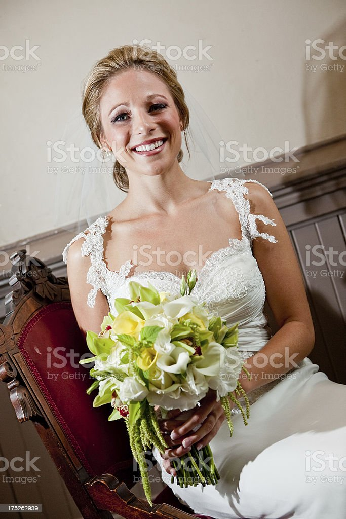 Beautiful Bride in White Wedding Dress with Floral Bouquet royalty-free stock photo