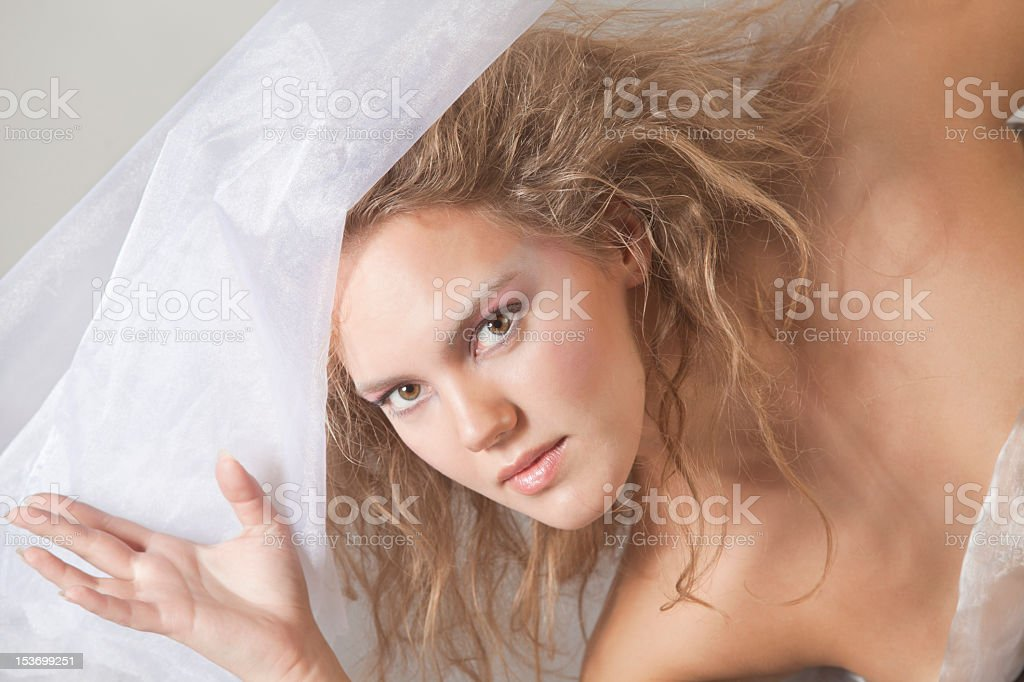 Beautiful bride is looking to the camera stock photo