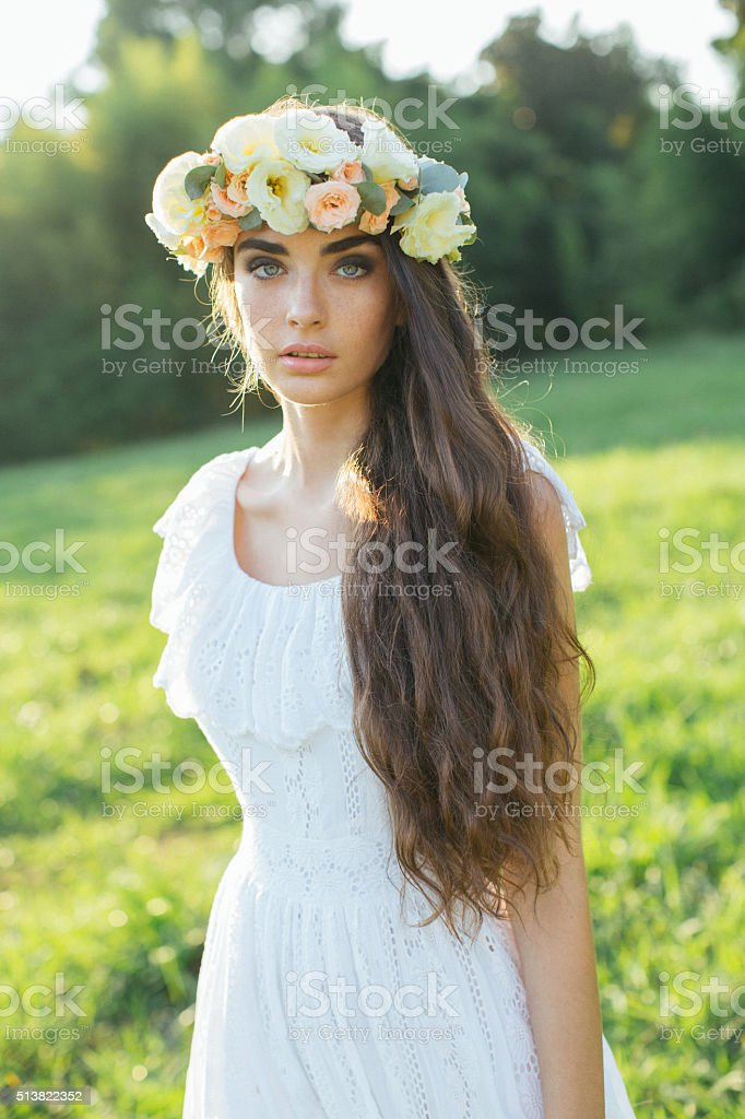 Beautiful bride on a background of summer forest stock photo