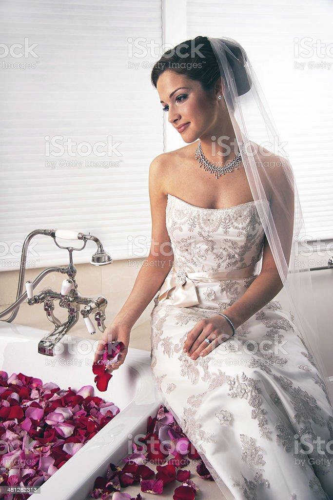 Beautiful bride on bath stock photo