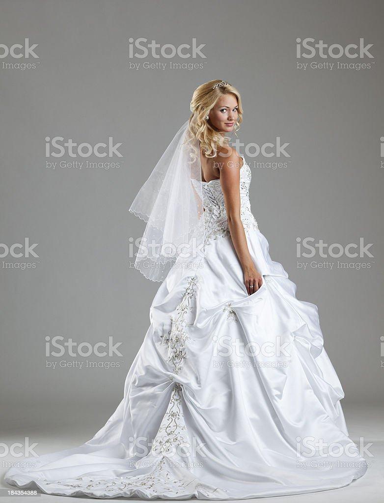 Beautiful bride on gray background stock photo