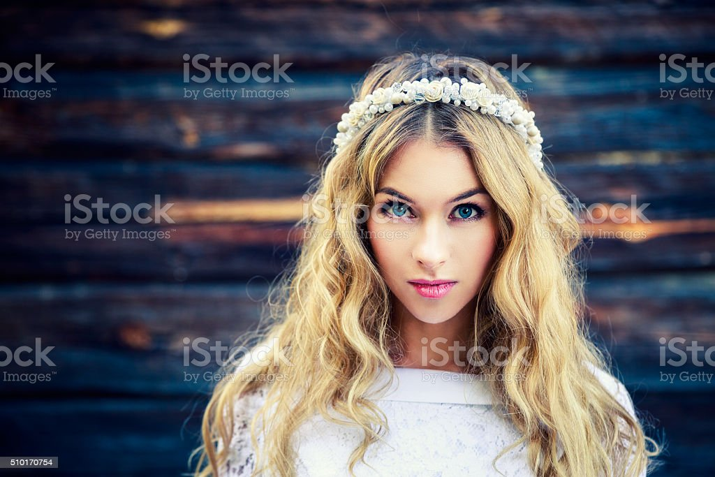 Beautiful Bride on Wooden Background stock photo