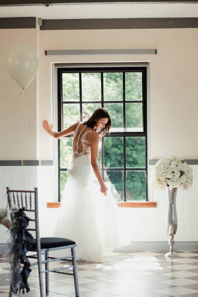 Beautiful Bride Posing At The Window stock photo