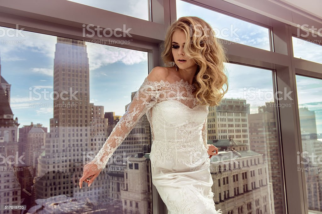 Beautiful bride posing in luxury Manhattan penthouse apartments stock photo