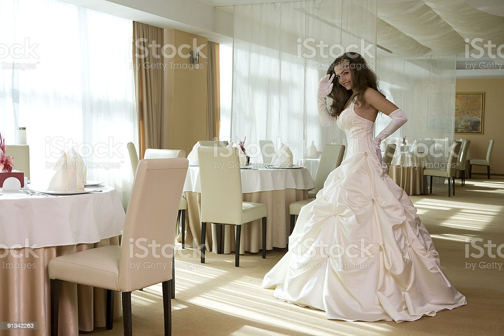 Beautiful bride standing at the restaurant. stock photo