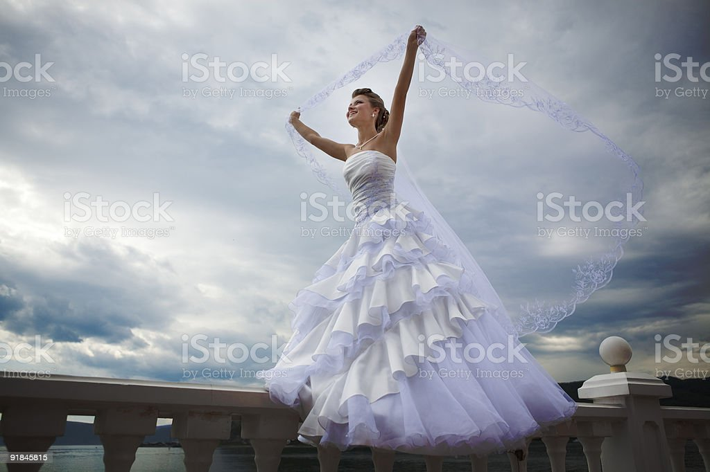 Beautiful Bride walking on the terrace with veil. XXXL royalty-free stock photo