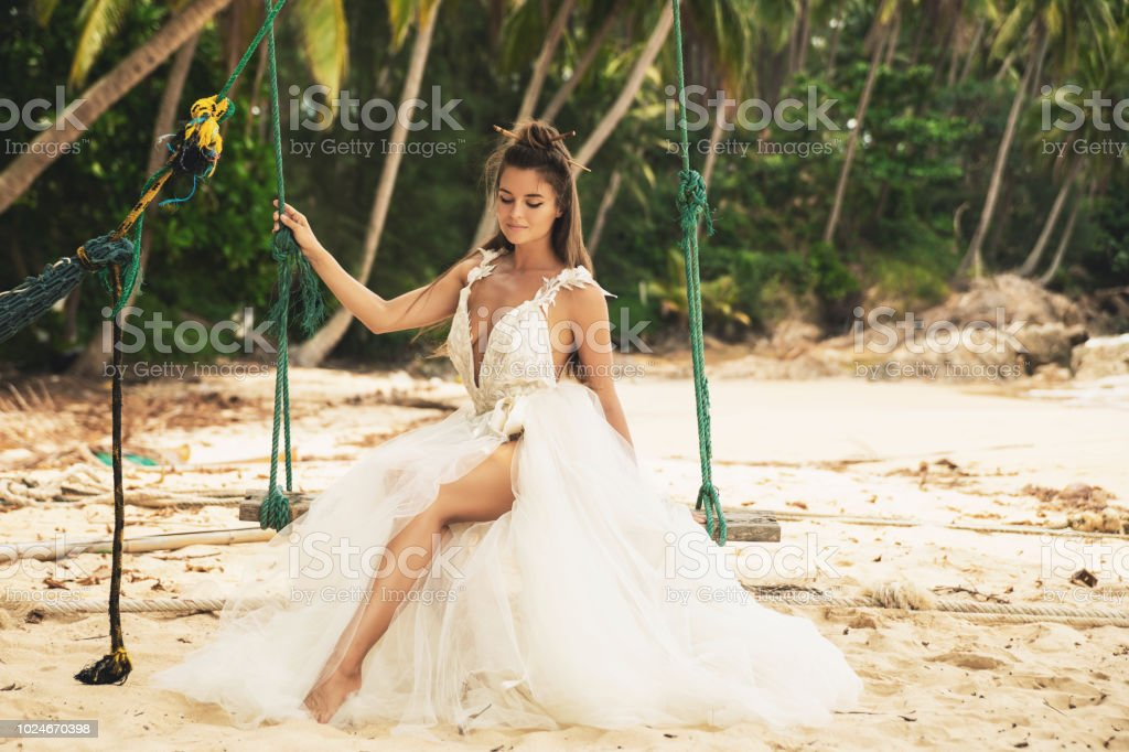Beautiful Bride Wearing Wedding Dress On The Tropical Beach Stock