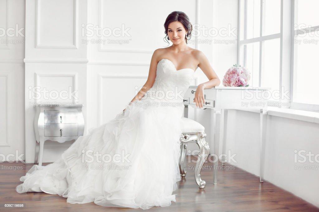 Beautiful bride. Wedding hairstyle make-up luxury fashion dress concept stock photo