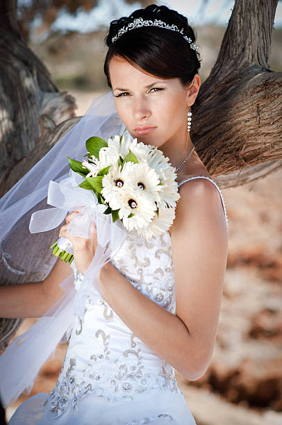 Beautiful bride with wedding bouquet outdoors. stock photo