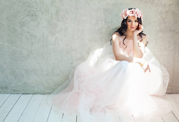 Beautiful bride woman in tulle roses wedding dress lifestyle portrait picture id1131860971?b=1&k=6&m=1131860971&s=612x612&w=0&h=yumywuu8hqjiccpwqzvl8p0bs88nn0ype43gwrpteo0=