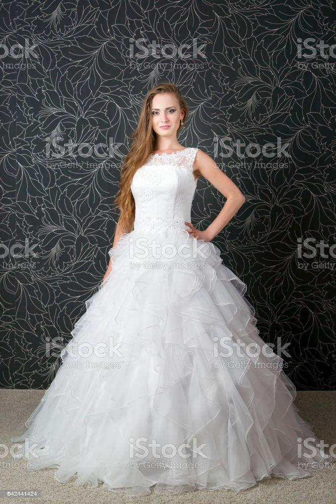 Beautiful bride, young woman in white wedding dress stock photo