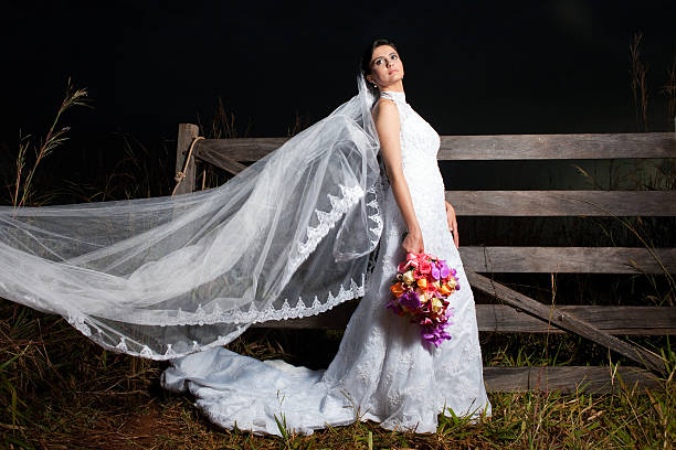 Beautiful Bride's Dress and Bouquet at night in a farm - foto de acervo