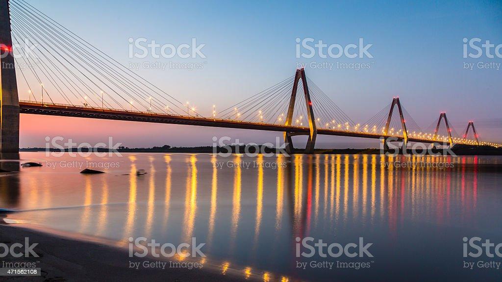 A beautiful bridge in Nhat Tan at sunset stock photo