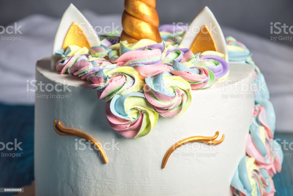 Beautiful bright cake decorated in the form of fantasy unicorn. Concept of a festive dessert for kids birthday stock photo