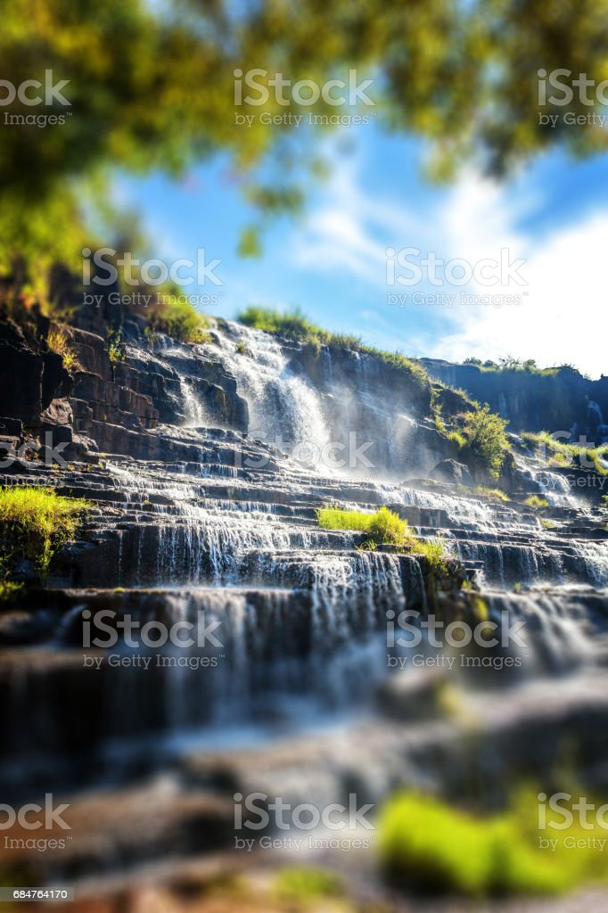 Beautiful bright landscape with waterfall stock photo