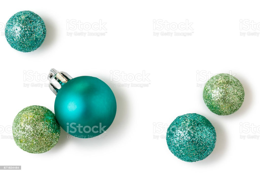 Beautiful, bright, modern Christmas holiday ornaments decorations in contemporary trendy blue and green colors with sparkling glitter on white background royalty-free stock photo