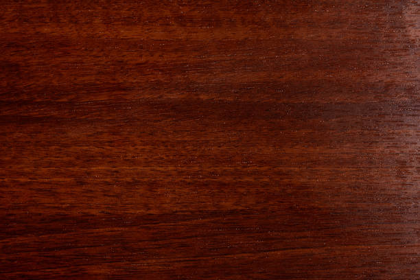 Beautiful brown wood background on lacquered textured plywood Dark wood table texture background top view lacquered stock pictures, royalty-free photos & images